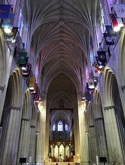 National Cathedral ~ looking down the nave (karma (Karen)) Tags: washingtondc thenationalcathedral nave arches windows flags stainedglass iphone cmwd topf25