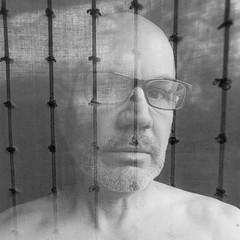 screen test (Super G) Tags: scs251 selfportrait incameradoubleexposure screen cloth face glasses square bw blackandwhite spc