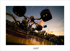 swinging at the easter-fair (Zino2009 (bob van den berg)) Tags: fair easter annual deventer local playground lichts sunset cold twisting turning spinning sick color sharp tokina f35 silhouettes shape cloud ornage orange speed holland thursday zino2009 reflection
