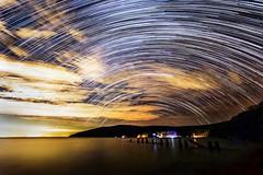 Light On A Cloudy Night (miTsu-llaneous) Tags: trinidad trinidadandtobago landscape seascape astrophotography startrail stars camping island caribbean nikon d5200 tokina 1116mm astronomy