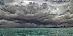 Low (simonjmarlan) Tags: storm clouds zanzibar rain ocean waves