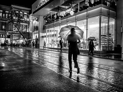 Out in the rain (tritranla) Tags: losangeles artistic blackandwhite california candid city mirrorless monochrome olympus people rain reflections streetphotography urban