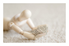 16/52: Reading is to the mind what exercise is to the body...Joseph Addison (judi may) Tags: april2017amonthin30pictures mannequin dof depthoffield bokeh highkey reading book carpet texture beige wood woodenmannequin canon7d macro soft softness pastel pale stilllife