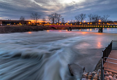 Rapid ends the day (tquist24) Tags: hdr indiana mishawaka nikon nikond5300 outdoor stjosephriver bridge clouds evening fence footbridge geotagged lights longexposure reflection reflections river rocks sky starburst sunset tree trees water unitedstates