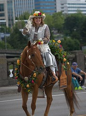 Riding Into Town (swong95765) Tags: woman female lady horse riding parade flowers beauty pretty ride