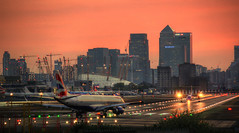 Crowded Runway (andy.gittos) Tags: london sunset plane aviation canary wharf o2 arena aircraft city airport lights skyline red sky british airways