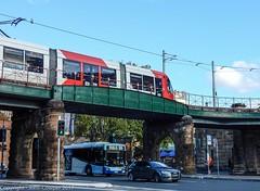 Sydney Light Rail - LRV2123 arrives at the Railway Colonnade (1) (john cowper) Tags: sydneylightrail lrv2123 eddyavenue railwaycolonnade railwayheritage bridge overbridge urbos3 centralrailwaystation sydneypublictransport lightrailvehicle lightrail sydney newsouthwales