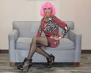 Cortney Pink wig and  Red Black pattern dress sitting on the couch