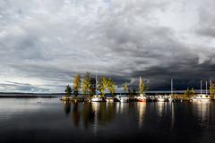 boats (cznr) Tags: autumn sky lake color reflection fall water clouds contrast canon finland dark boats finnland day cloudy tampere nsijrvi
