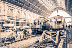 Keleti Train Station (JavierVazquez) Tags: voyage old city travel people sculpture sun reflection building clock window public beautiful station electric architecture clouds vintage wagon nice fantastic wire colorful europe hungary cityscape traffic antique famous watch budapest transport platform rusty fast rail railway landmark east transportation destination passenger sight passage timetable keleti hungarian shunter pantograph shunting