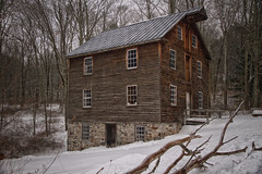Snow at Millbrook (SunnyDazzled) Tags: snow cold mill house winter rural history museum replica trees wood siding stone walls windows doorway rustic building