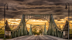 dramatic sky over the bridge of glienicke (bocero1977) Tags: building bridge old germany outdoor potsdam glienickerbrücke light berlin cloudporn historical road storm weather sunset dramatic architecture sky street darkness clouds metal