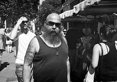 Invested (Shot In The Street) Tags: streetphotography leicam6ttl tattoo ilfordhp5 street bw film analogue monochrome leicam6 sunglasses bristol filmisnotdead black beard glasses blackandwhite candid white