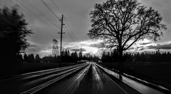 In Motion (Melissa_JMH) Tags: drive driving bw mono black white blackwhite blur blurr motion street highway trees power lines tree sky sunset sun light dark lg phone g5 lgg5 cellphone outside world oregon outdoors