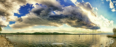 Easter Clouds (alessiochiolo) Tags: lago lake clouds cloudy cloud nuvole nuvolo sky cielo pasqua varese italia italy ita sun sunny sole nature natural natura sunset tramonti easter panoramic panorama samsung smartphone photography wide view tramonto rural water waterscape landscape land paesaggio acqua light calm quiet good day colors spring air primavera weather storm