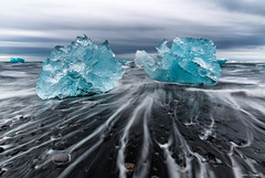 Ice Sculptures (MRC Imagery) Tags: ice crystalbeach cold winter water beach pebbles longexposure streaks iceland 1635mm 5dmk3 blue clouds cloudy volcanicsand wet weather outdoor adventure