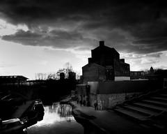 ** (donvucl) Tags: london kingscross granarysquare building canal boats figures sky clouds urbanlandascape bw blackandwhite olympusem1 donvucl