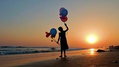 Celebration (pallab seth) Tags: silhouette girl balloon odisha puri bayofbengal india sunset playing samsungnx300m samsung16mmf24ifunctionlens flickrlogo orissa 2016