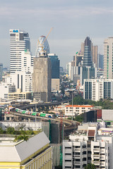 The BTS skytrain among Bangkok's Skyscrapers. (baddoguy) Tags: above bangkok buildingexterior builtstructure capitalcities cityscape colorimage comfortable community curve day economy financeandeconomy growth highangleview humansettlement nopeople outdoors photography railtransportation skyscraper southeastasia thailand trainvehicle transportation travel traveldestinations unusualangle urbanskyline vacations vertical