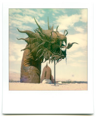 the sea serpent. borrego springs, ca. 2015. (eyetwist) Tags: eyetwistkevinballuff eyetwist polaroid desert seaserpent dragon ricardobreceda metal sculpture art borregosprings california sx70 impossibleproject color beta 600 testfilm polaroidsx70 impossiblecolorgen20beta generation20 vintage modified landcamera emulsion film instantgratification goop streaks flaws spots sooc analog analogue ishootfilm instant integral monster giant huge beast sharp american west breceda borrego springs dry arid galletameadows welding sandiego skyart saltonsea sonorandesert sonoran rust rusty iron steel welded anza anzaborrego teeth fangs tongue sea serpent dragonbreath america americana americantypology roidweek roidweek2017