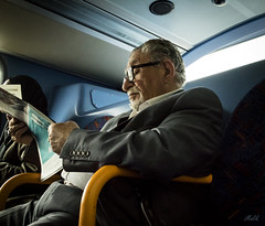 Project 365; #114 (iMalik1) Tags: project 365 days photo day challenge picture potd journey home after work old man reading paper newspaper public transport arab elderly tfl london central diverse square crop commute canon eos m3 street photography imalik