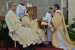 Deacon Boyd receives the Book of the Gospels