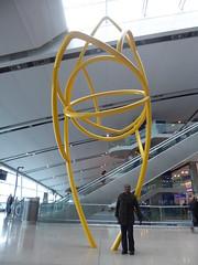 Louise has arrived (seikinsou) Tags: spring kenyatour udp urbandevelopmentprogramme ireland dublin airport sculpture terminal2 arrival yellow