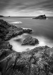 Pentire Point & Beyond (Mick Blakey) Tags: coastsurf slowexposure tidal rugged cornish coastpath rocky sea pentirepoint shadows vista contrast rocks monochrome newquay coastline coastal cliffs clouds seascape coast cornwall blackwhite surreal