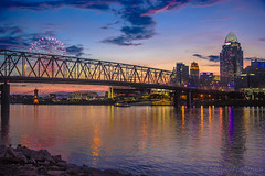 Cincinnati Skyline with fireworks (Raji Vathyam) Tags: bridge pink blue sunset ohio sky orange colors skyline night twilight purple fireworks kentucky cincinnati games newport taylor reds levee southgate