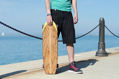 Longboarder. (Rares M. Dutu) Tags: lighting friends portrait sun fashion 35mm shoes flickr friendship board skating portraiture kicks navypier summertime relaxation mensfashion longboarding longboarder relaxingwithfriends nikond7000