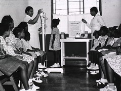 a016140 Black Kids Screened (Children's Bureau Centennial) Tags: scale children health 1960s exam healthcare weight nurses height boysandgirls historyofmedicine nationallibraryofmedicine africanamericanchildren childrensbureau africanamericannurse