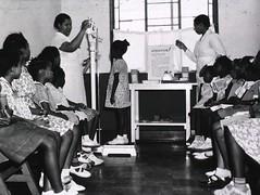 a016140 Black Kids Screened (Children's Bureau Centennial) Tags: scale children health 1960s exam healthcare weight nurses height boysandgirls historyofmedicine nationallibraryofmedicine africanamericanchildren childrensbureau africanamericannurse