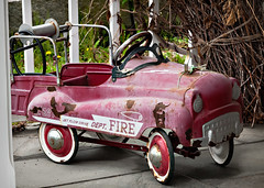 pedal car on a porch, Lenox, MA (1767, pop. 1,675), USA (lumierefl) Tags: usa ma toy unitedstates massachusetts newengland firetruck northamerica northeast lenox pedalcar berkshirecounty quadracycle
