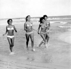 Bikini models running on the beach: Pensacola, Florida
