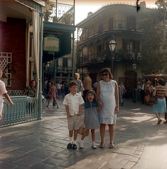 080566 05 (ndpa / s. lundeen, archivist) Tags: california ca family boy vacation people woman color 6x6 film girl sunglasses architecture kids buildings mediumformat children nicole child dress sister brother disneyland nick mother august maggie siblings shades pregnant 1966 shorts antiques 1960s alexander southerncalifornia anaheim neworleanssquare dewolf nickdewolf photographbynickdewolf