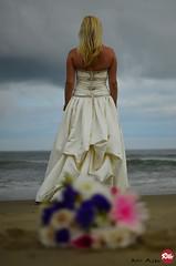 Stormy Weather (Red Weasel Media) Tags: ocean flowers storm water clouds bride sand nikon dof stormy noflash vabeach virginiabeach oceanfront nikon35mm rwm kirkallen nikon35mm18 nikond5100 redweaselmedia