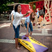 Students enjoy a game of corn hole during their shift at Shack-A-Thon.