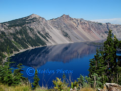 Crater Lake National Park in Oregon (6) (moelynphotos) Tags: trees mountains reflection nature oregon volcano scenery caldera craterlake craterlakenationalpark llaorock volcanicbasin moelynphotos