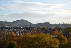 Over the rooftops to Arthur's Seat and Calton Hill, Edinburgh (Deborah S-C (InTheFairyGarden)) Tags: blue autumn trees panorama history clouds gold golden edinburgh skies rooftops bright foliage holyrood views newhaven autumnal caltonhill arthursseat chimneys november2013 panasoniclumixdmcfz72