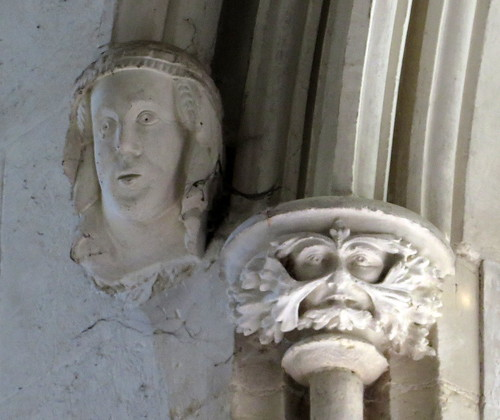 Chancel window Green Man capital and Wary-Woman corbel (c.1330), the Church of St Mary, Dennington, Suffolk, England