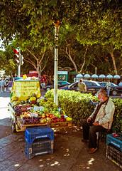 Fruit Seller - Rhodes Town (Fuji XM1 & 16-50mm) (markdbaynham) Tags: street people fruit greek town fuji zoom candid hellas x greece grecia trans rodos rhodes fujinon seller hellenic xm1 1650mm digitaldepotcouk
