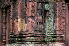 Banteay Srei - Delicate Lotus Flower Women and Filigree (Drriss & Marrionn) Tags: travel cambodia southeastasia shiva stonecarvings hindutemple banteaysrei archeologicalsite khmerart citadelofwomen
