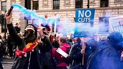 Man with a Blue Flare (stevedexteruk) Tags: protest demonstration nhs national health service flare protestor no cuts placard london uk whitehall city westminster marxist 2017 politics finger