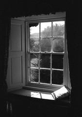 Window Seat (Man with Red Eyes) Tags: trix kodak hc110 160 115mins v850 leicam2 summicron35mmf2 v4 alnwick ingram northumberland analog blackwhite monochrome silverhalide sunnysixteen 35mm film filmisnotdead window windowseat cutains framed view glass smallpanes
