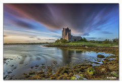 Dunguaire's Castle (Ken Duke 03) Tags: sunset sigma1020 shore sun serene rocks reflection ireland canon60d colours clouds coclare sea landscape sky water