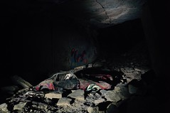 Wrong place to park. (Yvan S) Tags: exploration car career quarry abandoned red wreck old tag rock light dark darkness night cave voiture carrière abandonné rouge épave vieux pierre lumière sombre nuit grotte france nikon d90