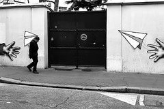 By dreaming to fly (pascalcolin1) Tags: paris13 homme man avions planes paper papier photoderue streetview urbanarte noiretblanc blackandwhite photopascalcolin