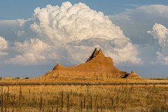 cloud capped (Christian Collins) Tags: canoneosrebelt2i badlands southdakota dakotadelsur cumulus ef70200mmf4lusm formation cloud clouds grass weeds redrocks badlandsnationalpark