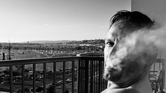 Vapor (Blue Rave) Tags: 2017 ca california sandiego bw blackandwhite barechest shirtless bloke dude guy male mate people smoker smoking smoke bay water sandiegobay goatee patio