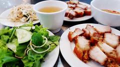 Roast pork Vietnamese style (Roving I) Tags: roastpork vietnamesecuisine sprouts greens vegetables sauces mint cucumber lettuce dining cafes danang vietnam